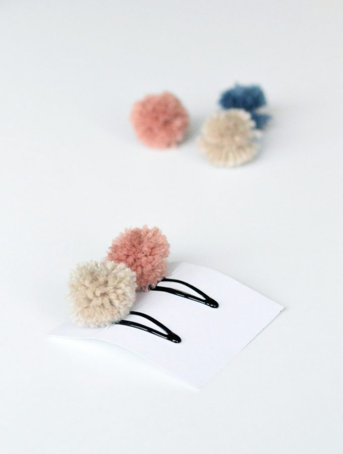 Make these pretty pompom hair clips