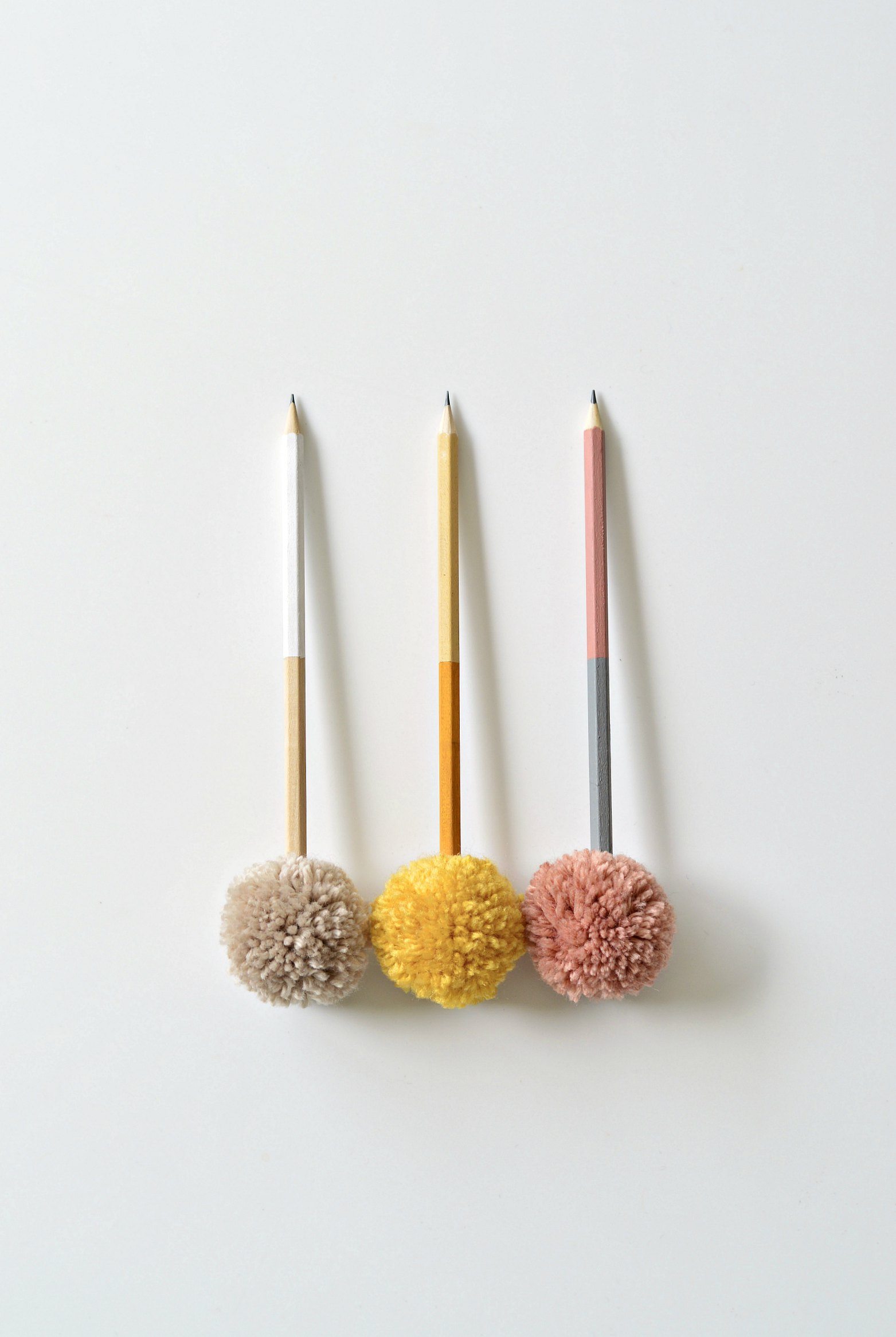 DIY color blocked pompom pencils