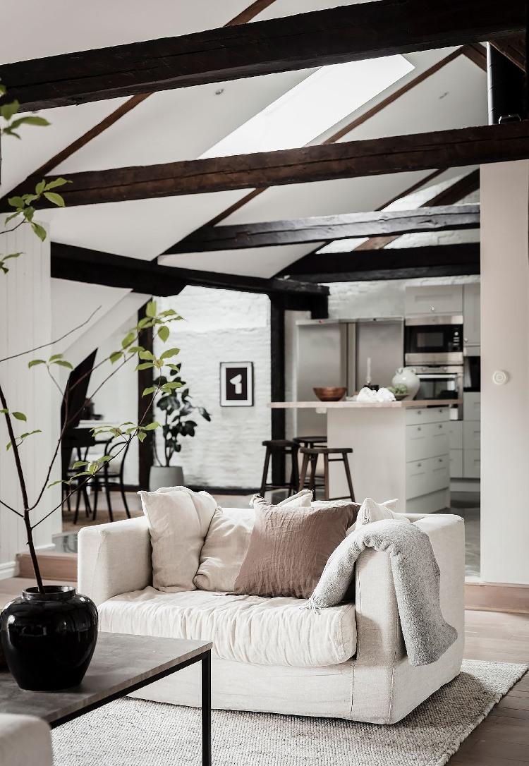 Scandinavian loft apartment exposed beams
