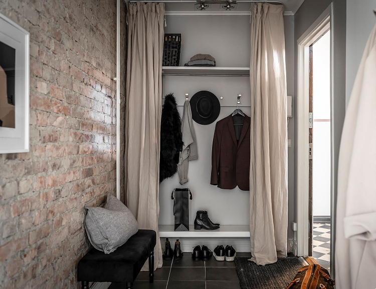 entryway with exposed brick wall