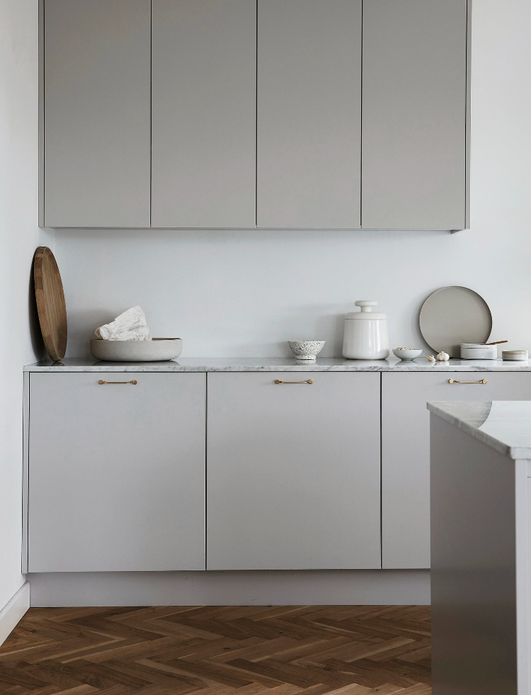 light grey kitchen with marble countertops